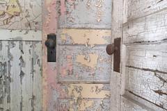 Lyman (Jonnie Lynn Lace) Tags: abandoned abandonedamerica texture textures peelingpaint paintchips derelict decay decayed decaying chasinglight lyman lymanstateschool lymanschool doors doorknobs skeletonkeys skeletonkey abandonedoors mood urbex