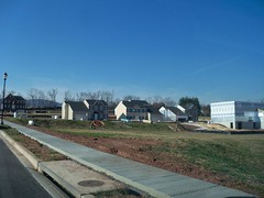 New home construction, in Frederick, Frederick County, Maryland, USA. (sebypires) Tags: county city houses usa house building home real dc washington md construction bedroom community cookie estate metro suburban suburbia fast progress maryland neighborhood growth master commute area commuter suburb growing sprawl build residential rapid development cutter metropolitan frederick planned mcmansion suburbanization subdivision urbanization rapidly cdp mcmansions exurban urbanized exurb suburbanized