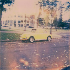 lemon. (after october) Tags: film vw oregon bug volkswagen portland polaroid beetle retro pearldistrict pacificnorthwest instant parkblocks polaroid600 theimpossibleproject