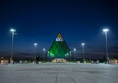 Palace of Peace and Reconciliation at night, Astana, Kazakhstan (Eric Lafforgue) Tags: lighting people building green monument horizontal architecture night outside outdoors person vanishingpoint exterior nightshot pyramid streetlamps streetlights capital vert structure nightview capitale centralasia kazakhstan nuit pyramide kazakh modernarchitecture personne humanbeing sights easterneurope lampadaire batiment eclairage astana brianclarke streetlighting edifice dehors eclairagepublic fosterandpartners exterieur pointdefuite photodenuit vueexterieure etrehumain palaceofpeaceandreconciliation akmola akmolinsk achitecturemoderne palaisdelapaixetdelareconcialiation kz8268