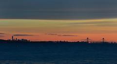 Manhattan Skyline Sunrise (hpaich) Tags: new york nyc morning bridge sky cloud ny newyork color reflection water skyline dawn bay early skies nuvola reflect cielo nuvem nube wolk verrazano pilv manhattansunrise
