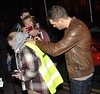 Singer Michael Buble signs a fan hi-vis bib outside The Merrion Hotel Dublin, Ireland