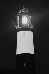 Light Of hope . (Ray Bradshaw.) Tags: uk red lighthouse white nature vertical closeup architecture outdoors photography guidance nopeople direction protection clearsky portlandbilllighthouse britishculture placeofinterest dorsetuk colourimage consumerproduct builtstructure billofportland raybradshawphotograthyraymondbradshawphotograthylighthouse raybradshawphotograthyraymondbradshawphotograthylighthousedorsetsafety