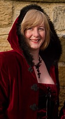 7D0035c Lovely pic of  Daughter  in red hooded coat with black fur - Whitby Goth Weekend 3rd Nov 2012 (gemini2546) Tags: nov fur wine goth week coloured 3rd hooded black 2470  canon sigma hair 7d lens hood lovely daughter beads blond whitby 2012 cape victorian
