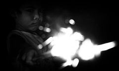 fired (polo.d) Tags: firework fire light bokeh night candle kid child fun play monochrome noir portrait sparks boy youth