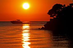 Boat and Sunset (craigsanders429) Tags: sunsetphotography sunsets sunset lakeerie lakeerieinohio greatlakes catawbaisland catawbaislandstatepark water lakes sun