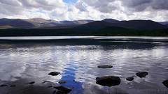 The sky above Loch Morlich (lunaryuna) Tags: scotland cairngorms nationalpark queensforest lochmorlich lake hills water landscape ripples sky clouds cloudscape reflections distortions beauty summer season lunaryuna
