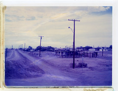 Bombay Beach, CA (moominsean) Tags: california clouds polaroid desert mud monsoon 4x5 dust largeformat trailers graflex crowngraphic bombaybeach type559 expired022005 fujipa45