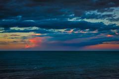 Rain In the Distance (stewartbaird) Tags: pink blue sunset red sea newzealand seascape nature rain clouds landscape waves peace sundown titahibay sxbaird stewartbaird