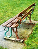 These are no snakes in the grass (Steve Taylor (Photography)) Tags: park wood blue newzealand christchurch wet grass metal vintage bench concrete branch snake seat lawn canterbury nz southisland cbd settle hagley snakeinthegrass damppatch goldenart