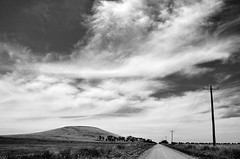 Bald Hill Road (phunnyfotos) Tags: road sky bw cloud weather clouds rural mono spring nikon skies farm hill australia monotone victoria powerlines lane vic powerline dirtroad gravelroad carisbrook centralvictoria d5100 nikond5100 phunnyfotos