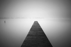 Infinity (martijnvdnat) Tags: longexposure autumn blackandwhite mist lake water netherlands weather fog landscape outside outdoors landscapes pier vanishingpoint nikon exposure day outdoor jetty horizon fineart thenetherlands minimal minimalist valkenburg fogg leadinglines landscapephotography d90 cmartijnvdnat valkenburgsemeertje