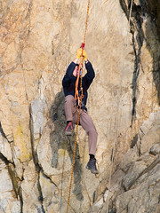 hanging climber on the rope (Maxim Tupikov) Tags: people cliff mountain holiday man up sport rock wall danger happy person drive climb movement risk hiking extreme helmet competition rope boulder adventure equipment climbing alpine cap backpacking mountaineering target bouldering acrobat ladder climber activity elevation rockclimbing success hold active mountaineer teamwork belay alpinism adrenalin mountainclimber alpinist extremal