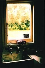 Strange Kitchen (Sun.Child) Tags: blur film window kitchen 35mm lens bathroom haze sink pentax k1000 iso mm burst tap 35