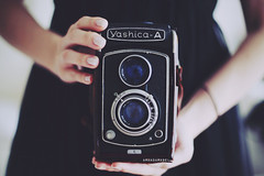 The Yashica-A (Amanda Mabel) Tags: camera light portrait black macro tlr film vintage lens photography hands soft sister fingers delicate yashica whitelight ilovephotography wrists yashicaa silvernailpolish twinlensreflexcamera amandamabel