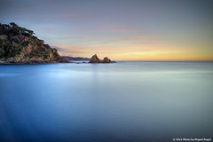 Blanes  Santa Anna (mireba72) Tags: longexposure blue light sea sky costa seascape color travelling luz beach water azul marina landscape puerto lights harbor landscapes mar spain agua nikon exposure mediterraneo colours snorkel seascapes natural stones playa paisaje girona catalunya litoral calma costabrava aigua cala rocas buceo blanes guijarros d90 sedoso peascosa sensibilitzaci mireba calapuntasantaanna