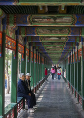 Couple Sit In A Summer Palace Corridor, Beijing China (Eric Lafforgue) Tags: china people color colour vertical architecture person photography couple asia day pillar beijing corridor  groupofpeople kina chin cina chine xina  eastasia  chineseculture pekin realpeople tiongkok capitalcities  colorimage chiny  kna in fulllenght colorpicture   trungquc mg0621 na   kitajska tsina      groupofpersons
