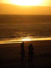 On the beach (shaggy359) Tags: sunset sea two people beach water silhouette yellow women waves silhouettes wave dorset bournemouth hants