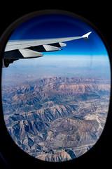 Forgotten rebel ( Sooty ) Tags: leica q summilux f17 17 28mm 28 asph type 116 hemingway plane window landscape arid mountain iran iraq border