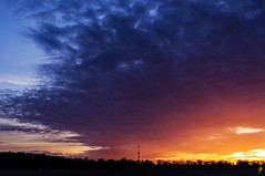 Stuck in the middle (jcdriftwood) Tags: stuckinthemiddle center between sunset sundown evening twilight tower horizon treeline