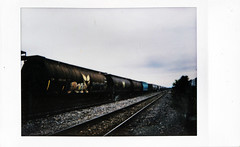 (|Digital|Denial|) Tags: instax fujifilm instantphotography analog colour summer trains freight railroad traintracks vanishingpoint converginglines horizon sky