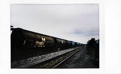 (|Digital|Denial|) Tags: instax fujifilm instantphotography analog colour summer trains freight railroad traintracks vanishingpoint converginglines horizon sky