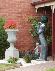 Tiny Artistic Garden (mikecogh) Tags: seaton statue artistic sculpture publicart urn flowers