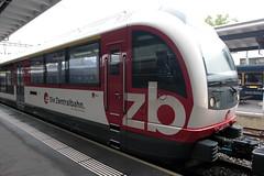 Zentralbahn ZB Gelenktriebwagen ABReh 150 101 - 1 mit Taufname Meiringen und 150 201 - 8 mit Taufname Bern  ( Alpiner dynamischer leichter eleganter Reisezug 7 - teilig - Triebwagen Hersteller Stadler Rail ) am Bahnhof Interlaken Ost im Berner Oberland im (chrchr_75) Tags: albumzzz201609september christoph hurni chriguhurni chrchr75 chriguhurnibluemailch september 2016 schweiz suisse switzerland svizzera suissa swiss kantonbern kanton bern berner oberland hurni160905 bahn eisenbahn schweizer bahnen zug train treno albumbahnenderschweiz2016712 albumbahnenderschweiz albumzentralbahn zentralbahn zb juna zoug trainen tog tren поезд lokomotive паровоз locomotora lok lokomotiv locomotief locomotiva locomotive railway rautatie chemin de fer ferrovia 鉄道 spoorweg железнодорожный centralstation ferroviaria