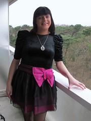 Smile (Paula Satijn) Tags: dress skirt pink black girl lady gurl tgirl bow miniskirt smile happy balcony view class elegance