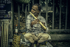 Tired Eyed Tune (negative_charge) Tags: flute charukola dhaka sell street old tune skill waterbottle  tired eyes