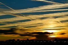 Sunset in London (greekguy29) Tags: city blue sunset sky orange cloud sun london lines dusk diagonal cloudscape