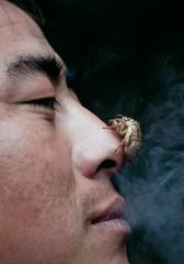 Smoking Bloke's Joke (edwindejongh) Tags: man face insect asian nose gesicht bhutan smoking insekt eyebrows azie neus gezicht enprofil wenkbrauwen tshering