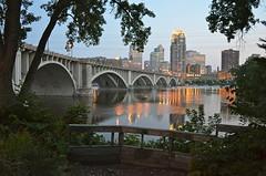 Minneapolis at dusk (seawolfz) Tags: park city bridge reflection minnesota lights nikon dusk minneapolis wells center fargo d5100