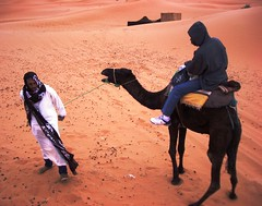 Having a fag on a camel... in Morocco (Sandrine Vivs-Rotger photography) Tags: africa sand desert northafrica tourists smoking camel morocco bedoin