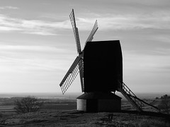 Brill Windmill on a Clear Afternoon (cycle.nut66) Tags: lighting trees winter blackandwhite sunlight house windmill four countryside view post side horizon low hill sails olympus vale round restored fields common brill zuiko greyscale thirds evolt e510 rounhouse monoochrome