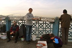 Istanbulites (desvisages.desfigures) Tags: bridge boy fish men turkey fishing turkiye istanbul  pescatori istanbulites