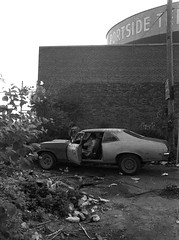 The good old days in Jersey City. The leaking gasoline tanks of Portside Terminal right on the Morris Canal. A guy sits in his old beat up Chevy Nova with mismatched rims and differently colored body panels amidst a pile of garbage and weeds. August 1981 (wavz13) Tags: oldphotographs oldphotos 1970sphotographs 1970sphotos oldphotography 1970sphotography vintagesnapshots oldsnapshots vintagephotographs vintagephotos vintagephotography jerseycityphotographs jerseycityphotos oldjerseycityphotography oldjerseycityphotos oldjerseycity vintagejerseycity gloomy urban vintagecars vintagecar oldcar oldcars 1960scars 1960scar collectiblecars collectablecars beatercar beatercars urbanwasteland industrialwasteland wasteland industry industrial bleak bleakwasteland pollution polluted brownfield brownfields jerseycityhistory pollutedwasteland dystopia dystopic filmphotography 35mm 1970sjerseycity industrialjerseycity oldnewjersey 1970snewjersey vintagenewjersey industrialnewjersey newjerseyhistory 1960schevy 1960schevrolet 1970scars 1970schevy abandonedplaces oldjersey slottedmags ovalmags urbanentropy urbanruins oldhudsoncounty vintagehudsoncounty ghettopalms postindustrial urbanexploration ghetto oldchevies vintagechevies chevrolet urbanphotography oldchevys vintagechevys