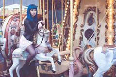 Saya (rubenfcid) Tags: carousel horse funfair tiovivo bluehair girl woman lady femme model fun fashion glamour shooting modeling leatherjacket dress pinkdress