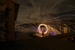 Checking for Sheds (Dan @ DG Images) Tags: wire wool spinning jetty boatshed port chalmers dunedin nz new zealand reflection broken ankle dgimages sky sunset round fire light blue glow stick