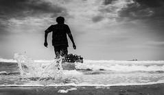 ganesh Visarjan (abisheksridhar1994) Tags: ganesh cwc chennaiweekendclickers chennai chaturthi festival people idol bw blacknwhite sky beach run water nikon d90 tamilnadu india
