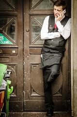 A Waiter's Call (garryknight) Tags: man london mobile nikon chat call phone cellphone conversation waiter lightroom 55200mmvr d5100