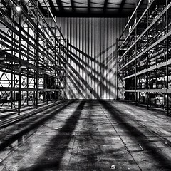 Light & Shadows (caribb) Tags: light blackandwhite bw lines square blackwhite intense industrial shadows artistic warehouse squareformat strong strength shelving hdr linear iphoneography instagramapp uploaded:by=instagram
