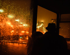 rainy night and bridge (andymudrak) Tags: lighting bridge people rain silhouette architecture night person looking cablecar vehicle