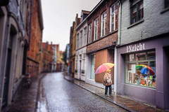 [travel] with rainbow (pooldodo) Tags: street city travel people urban woman umbrella rainbow europe belgium bruges tilt hdr pooldodo taotzuchang