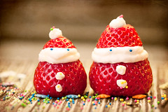Santa Berries (Oleksiy & Tetyana) Tags: santa christmas friends food macro canon dessert fun strawberry berry holidays newyear smiley santaclaus    thegalaxy    blinkagain flickrsfinestimages1