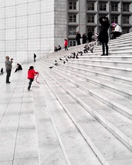 Two red jackets. (Sascha Unger) Tags: red people paris france rot mobile stairs rouge frankreich phone nanterre arc ladefense menschen treppe esplanade sascha defense grandearche iphone grandarche puteaux unger courbevoie iphonography iphoneography saschaunger