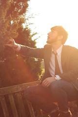 In the Act of Sunlight (Jonbearr) Tags: winter portrait sun man tree men leather pine bench beard glare desert boots watch tie advertisement jeans evergreen levi levis blazer conor bearded hamill chukkah