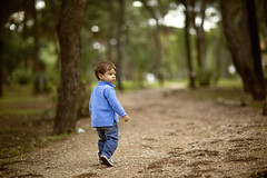 Small boy walking in a forest (Nasos Zovoilis) Tags: life park city blue light boy summer portrait people brown sun man cute male green smile face look childhood closeup youth forest hair fun outside happy person one kid bed model eyes hands europe alone child play hand sad little outdoor head expression background room small joy innocent young adorable lifestyle happiness son athens greece jeans health blond tired attractive casual worry inside curious lovely charming care facial hold caucasian