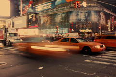 Times Square Taxi (falseverdict) Tags: city nyc newyorkcity urban ny yellow night dark ads lights manhattan cab taxi advertisement transportation timessquare billboards lighttrail 2011 laurenpaljusaj