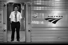 Amtrak Car Attendant (Christopher J. May) Tags: railroad bw train amtrak eastbound no6 californiazephyr nikond600